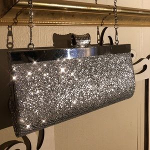 Silver sparkly hard clutch